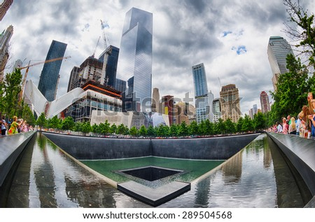 NEW YORK - USA - 13 JUNE 2015 people near freedom tower and 9/11 memorial - stock photo