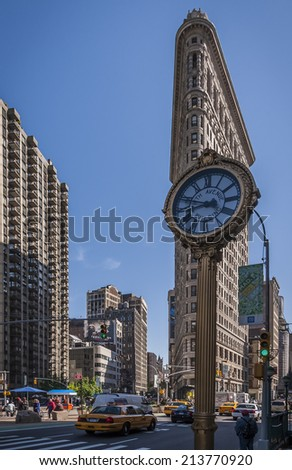 NEW YORK, USA - JUNE 10: Portrait of New York in the USA showcasing the iconic  Flatiron building and its surroundings on a busy day with lots of locals and tourists passing by on June 10, 2009.