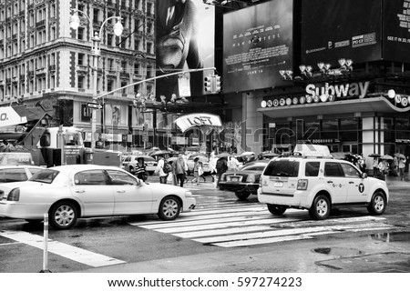 NEW YORK, USA - JUNE 10, 2013: Taxi drives along Times Square in New York. Times Square is one of most recognized landmarks in the world. More than 300,000 people pass through Times Square daily.