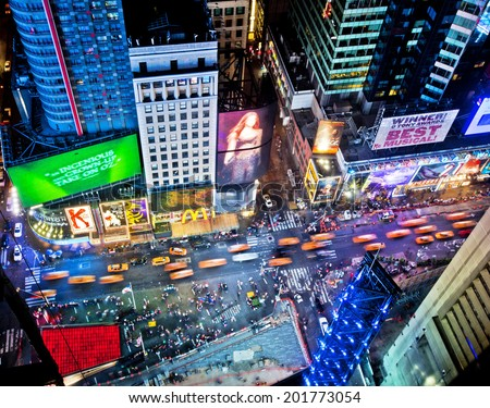 NEW YORK, USA - JUNE 29th, 2014: Aerial view of Times Square the popular New Year's Eve destination with crowds and taxi cabs in motion in New York City - stock photo