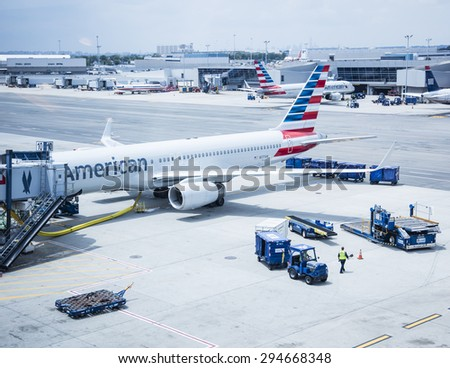 New York, USA - June 19th, 2015: American Airlines passenger jet being loaded at JFK airport in New York. - stock photo