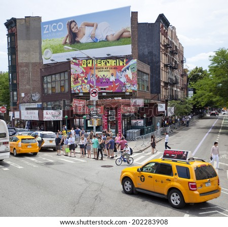 NEW YORK, USA - JUNE 28th 2014: Greenwich village the fashionable New York city district with people and yellow cabs