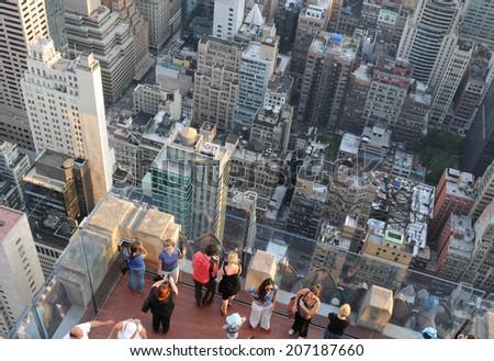 NEW YORK ,USA - JUNE 18: Tourists enjoy New York cityscape from Rockefeller center roof  on June 18 2011, New York USA. - stock photo