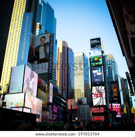 NEW YORK, USA - MARCH 26: Unknown people on Times Square. Times Square is a major commercial intersection and a neighborhood in Midtown Manhattan on March 26, 2014 in New York, USA - stock photo