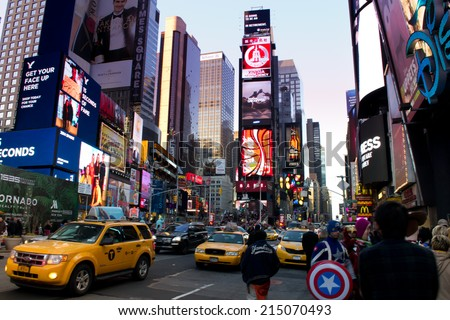 NEW YORK, USA - MARCH 26: Unknown people on Times Square. Times Square is a major commercial intersection and a neighborhood in Midtown Manhattan on March 26, 2014 in New York, USA