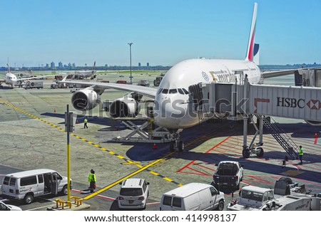 New York, USA - May 7, 2015: Airplane and jet bridge at the international airport