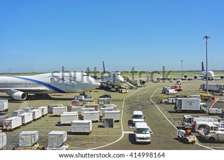 New York, USA- May 7, 2015: Airplanes with luggage and cargo at international airport