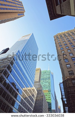 NEW YORK, USA - MAY 5, 2015: Looking up at skyscrapers in Lower Manhattan, New York City, USA           - stock photo
