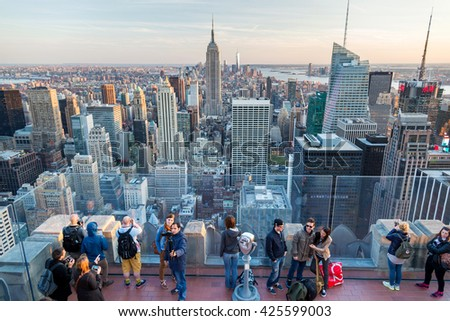 NEW YORK, USA - MAY 7, 2014: people look at Manhattan cityscape from the observation deck