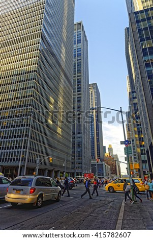 New York, USA - May 6, 2015: 6th Avenue and Skyscrapers in Midtown Manhattan, New York City, USA. Tourists in the street