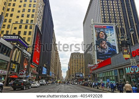 NEW YORK, USA - MAY 6, 2015: 7th Avenue in Midtown Manhattan, New York, USA. It is called Times Square. Tourists around - stock photo