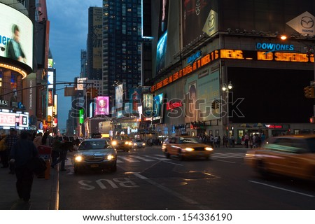 NEW YORK, USA, MAY 10th, 2013. Times Square urban night scene with taxis and cars passing by along 7th Avenue and advertising lights in New York City. Taken on May 10th, 2013. - stock photo