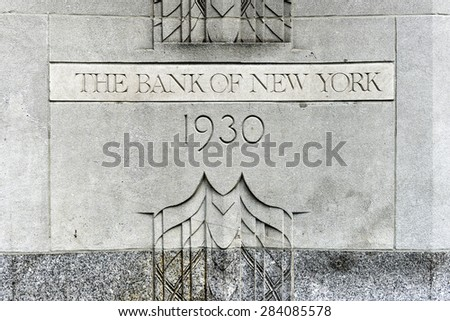 New York, USA - May 31, 2015: The Bank of New York Building cornerstone at 1 Wall Street, Manhattan. The Art Deco building is the current global headquarters of The Bank of New York Mellon Corporation - stock photo