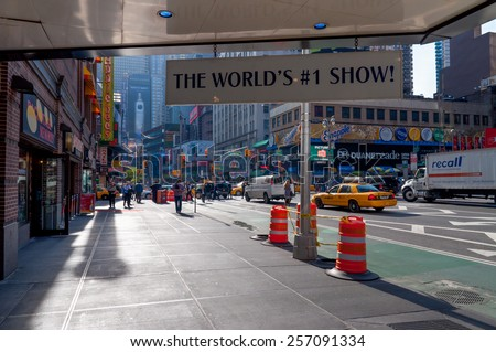 NEW YORK, USA - NOVEMBER 14: Near entrance to the theater to Mamma Mia! on Broadway in New York City, Time Square at November 14, 2011. Showing people and traffic on the streets of New York. - stock photo