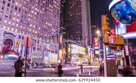 NEW YORK, USA - NOVEMBER 20: Panoramic view of New York city in the USA at Times Square with its neon lights, stores, and tons of tourists enjoying themselves on November 20, 2009.