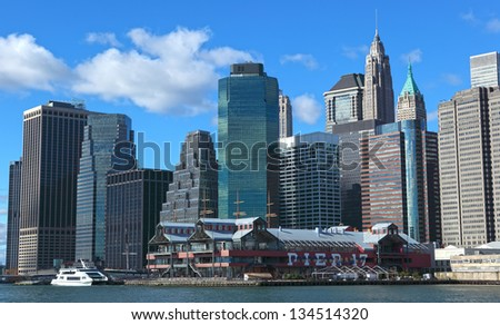 NEW YORK, USA  - NOVEMBER 15: The pier 17 is favourite vacation place with the old ships and museums on November 15, 2012 in Manhattan, New York. - stock photo