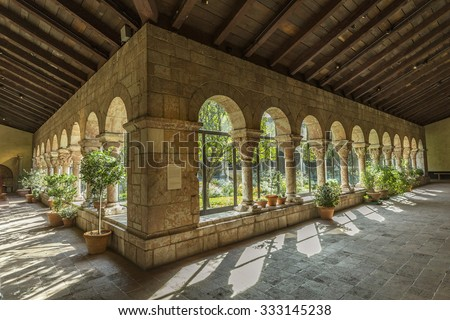 NEW YORK, USA - OCT 22, 2015: Colonnade and garden at The Cloisters, the branch of The Metropolitan Museum of Art devoted to the art and architecture of medieval Europe, , New York,USA - stock photo