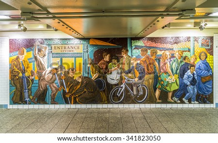 NEW YORK, USA - OCT 22 2015: mosaic made of tiles at the wall in station times square  in New York. With 1.75 billion annual ridership, NYC Subway is the 7th busiest metro system in the world.