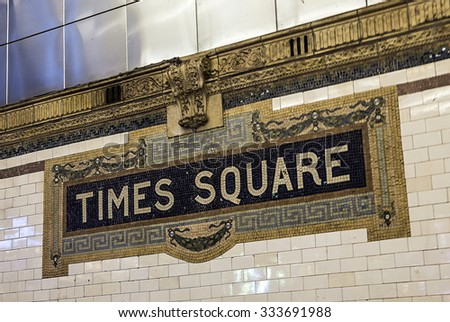 New York, USA - OCT 22, 2015: old vintage sign times square Subway Station in Manhattan. Intricate tiles with symbols  in terra cotta describe the place.