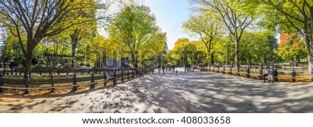 NEW YORK, USA - OCT 21, 2015: People enjoying walking in  Central Park. The park is the most visited urban park in the United States with 35 million visitors annually.