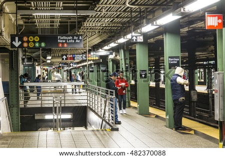 NEW YORK, USA - OCT 21, 2015: People wait at subway station Atlantic Avenue in New York, Brooklyn. With 1.75 billion annual ridership, NYC Subway is the 7th busiest metro system in the world.