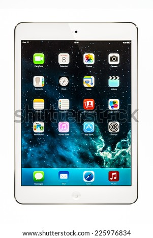 New York, USA - October 24, 2014: Apple iPad mini displaying iOS 7.1 homescreen. iOS 7.1 operating system designed by Apple Inc. official output 10 March 2014. - stock photo