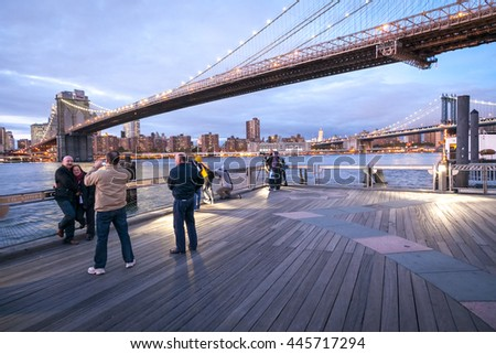 NEW YORK, USA - OCTOBER 1, 2009: Brooklyn bridge after sunset and tourists taking pictures, Brooklyn, New York, USA - stock photo