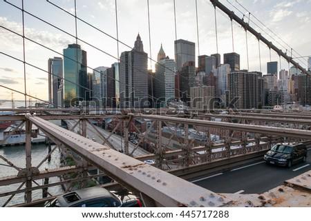 NEW YORK, USA - OCTOBER 1, 2009: Manhattan from Brooklyn bridge at sunset, Manhattan, New York, USA - stock photo