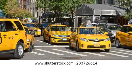 NEW YORK, USA OCTOBER 24: Taxi cabs on the street of New York City at October 24, 2013. There is 13,237 taxi cabs operating in New York City which have 241 million annual taxi passengers.  - stock photo