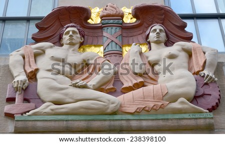 NEW YORK USA OCTOBER 27: The polychrome limestone Art Deco bas-relief sculpture,  Progress, is located above the north, 49th Street,   fa�§ade  of 1 Rockefeller Center. on October 27, 2013 in New York - stock photo