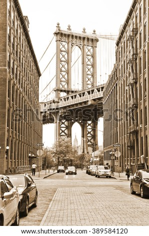 New York, USA - October 8 : View of Manhattan Bridge between buildings from Brooklyn, New York City on October 8, 2013. - stock photo
