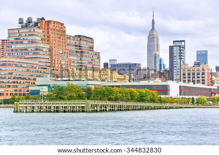 New York, USA - October 9, 2013: View of New York skyline in a cloudy day at Hudson shore in New York City on October 9, 2013. - stock photo