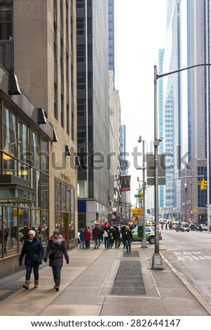 NEW YORK, USA / 08.02.2015 - People walking on 5th Avenue in typical New York street scene