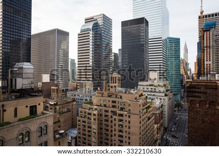 NEW YORK, USA - Sep 27, 2015: Chrysler building and manhattan modern architecture. Manhattan is the most densely populated of the five boroughs of New York City - stock photo
