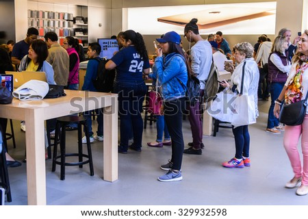 NEW YORK, USA - SEP 22, 2015: Interior of the Apple store on the Fifth Avenue, New York. The store sells Macintosh personal computers, software, iPod, iPad, iPhone, Apple Watch, Apple TV