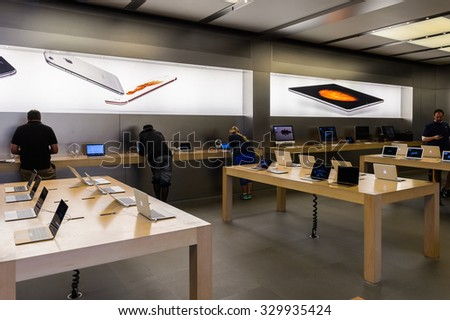 NEW YORK, USA - SEP 22, 2015: Interior of the Apple store on the Fifth Avenue, New York. The store sells Macintosh personal computers, software, iPod, iPad, iPhone, Apple Watch, Apple TV - stock photo