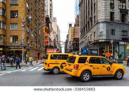NEW YORK, USA - SEP 22, 2015: Taxi cab at the Broadway street. It is the oldest north south main thoroughfare in New York City