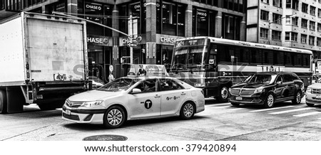 NEW YORK, USA - SEP 22, 2015: Taxi cab on the 6th avenue (Avenue of the Americas), 6 km long