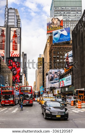 NEW YORK, USA - SEP 22, 2015: Touristic red bus at the Times Square, a major commercial neighborhood in Midtown Manhattan, New York City