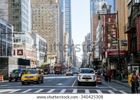 NEW YORK, USA - SEPT 20, 2015: People and taxi on the street of New York.