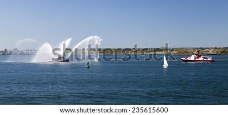 NEW YORK, USA, SEPT 27: The New York City Fire Department Boat practices maneuvers  in the Hudson River off New York City on September 27, 2014 - stock photo
