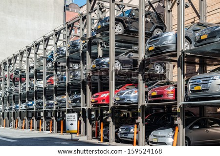 NEW YORK, USA - SEPTEMBER 28, 2013: An automated car parking system supporting the lack of parking lots in the city on September 28, 2013 in Manhattan, New York City, USA. - stock photo