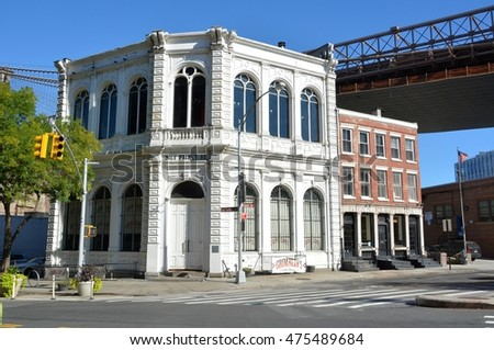 NEW YORK, USA - SEPTEMBER 24, 2015. Building on the intersection of Old Fulton St and Front St in Brooklyn, New York ,with Brooklyn Bridge, surrounding buildings and cars.
