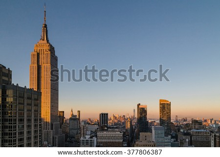 New York, USA -  4 September 2014:  Color image depicting a view of the Empire State Building and Lower Manhattan as dawn sunlight breaks over the city during summer.