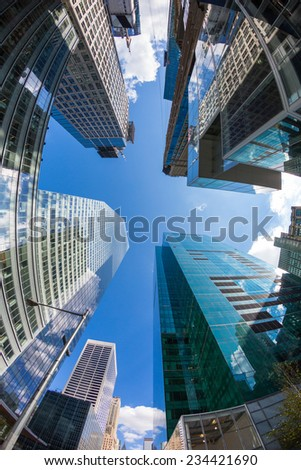 NEW YORK, USA - SEPTEMBER 7, 2014: Modern Skyscrapers in downtown, financial district. Low angle view with fish-eye lens. - stock photo