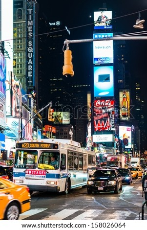 NEW YORK, USA - SEPTEMBER 28, 2013: The Times Square, one of the most visited tourist attractions in the world, at night on September 28, 2013 in Manhattan, New York City, USA. - stock photo