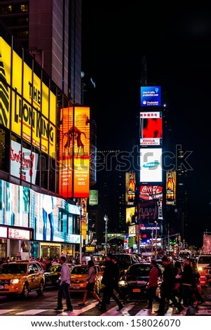 NEW YORK, USA - SEPTEMBER 28, 2013: The Times Square, one of the most visited tourist attractions in the world, at night on September 28, 2013 in Manhattan, New York City, USA.