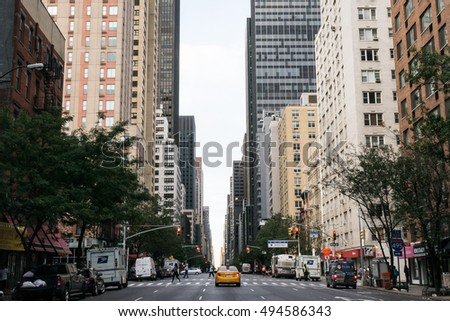 New York, USA - September 23, 2015:  Yellow taxi and people on the street of New York.