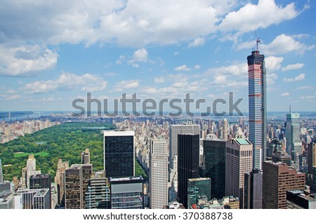 New York: view of Manhattan skyline, Central Park and 432 Park Avenue building under construction on September 16, 2014. The construction of 432 Park Avenue, 1396 feet high, was completed on 2015 - stock photo