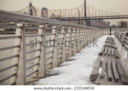 new york winter.Long island city bench in waterfront park - stock photo